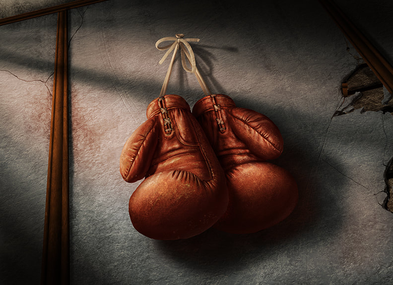 A pair of old, worn boxing gloves hangs by a leather cord from a hook along a wall.