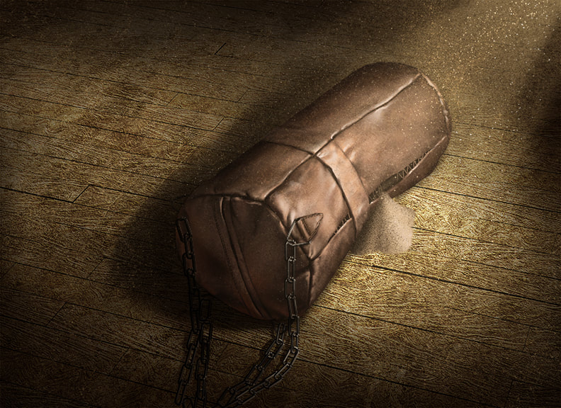 A leather punching bag lies on the concrete floor, completely beat up. Sand or grain of some kind spills out of a tear in the leather.